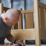 We showcase the very best of British Art & Craft in our shop. Here Iain Childs works on a chair