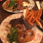 Sirloin steak with garlic prawns, callarmi, onion rings and sweet potato fries and mixed grill