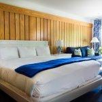 DELUXE ROOM: KING BED, SLEEPER SOFA, AND MURPHY BUNKS.