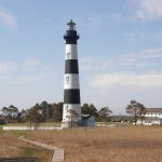 A view of the Bodie Island lighthouse and keeper's quarters as seen from the wildlife viewing ar