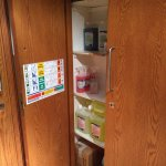 Cupboard open to corrosive cleaning chemicals