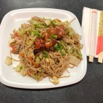 Fried noodles with chicken skewer
