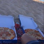 Pizza date on the beach.