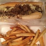 Cheese steak sub with fries
