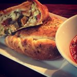 Spinach & Artichoke Dip Calzone | Creamy dip, organic chicken and house roasted green chilies