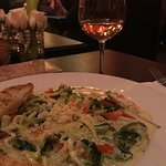 Zoodles with alfredo and a garden of vegetables enjoy with a nice glass of vino