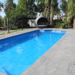 Extremely inviting and pristine pool, plenty of grassed area