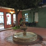 A charming courtyard surrounded by shops.