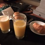 Fresh croissants and orange juice delivered to room daily