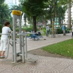 nice big park with outdoor equipment and exercise groups, walking