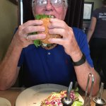 Trying to eat Swiss cheese burger and salad!