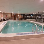 The pool and exercise area facing the Detroit River