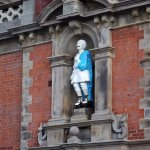 Statue above the Fisherman's Almshouses which overlook the river on Church Street