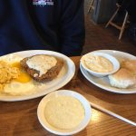 County fried steak, eggs, cheesy hash brown casserole, grits, and biscuits with gravy
