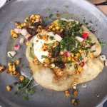 The spiced corn with eggplant and poached egg on turkish bread