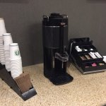 There's in room coffee maker and free coffee in the comfy lobby.