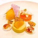 Perfect Mandarin sorbet, cherry meringue wafer with coconut dessert.