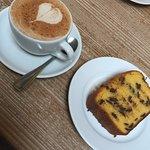 Chai latte and mandarin and cholocate cake
