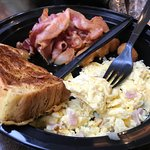 Scrambled eggs, bacon and french toast