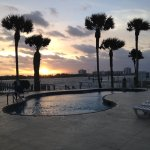 Sunrise view to pool and intercoastal waterway.
