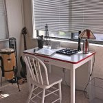 Cute writing desk and fun instruments.