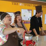 Having fun roasting and grinding cacao beans in chocolate class.