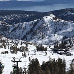 The gorgeous waters of Lake Tahoe can be seen while skiing at Squaw Valley.