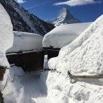 Findlen walking down to Franz & Heidi's -- to show how much snow there was in Zermatt this winte