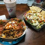 Our nach supreme with sour cream and one of our salads.