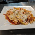 The Baked Mostaccioli is a mix of penne, marinara, and mozzarella cheese.