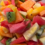 Breakfast in summer months is tropical fresh fruit salad at Huskisson B&B.