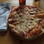 Seafood pizza was very good.