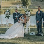 First Kiss at a Beautiful Lakeside Ceremony