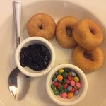 Kid's warm donuts with choc sauce dip and mini choc beans. Yum!