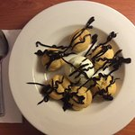 Delicious Profiteroles with ice cream.