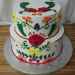 Spanish and New Mexico influenced piping on 2 tier cake