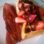 Room service - waffles with fruit and chocolate sauce.