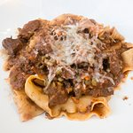 Pappardelle homemade fresh pasta ragu with chunky fine meat peaces