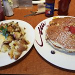 Banana and Strawberry Pancakes with a side of eggs and Rosemary Potatoes