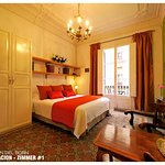 Room #1: King Size Bed  or Twin Beds + Balcony and Shared Bathroom = 110€ per night. 1 or 2 pers