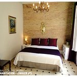Room #5: King Size Bed  or Twin Beds + Balcony and Shared Bathroom =95€ per night