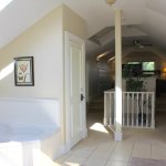 The Hemingway Hideaway. Open concept suite with large jetted bathtub.