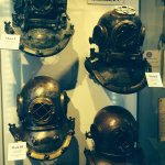 Four late 19th Century-early 20th Century diving helmets.....