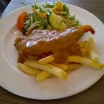 Parmigiana chicken with mushroom sauce, chips and salad