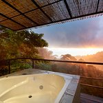 View of the sunset from the Treehouse Puma hot tub