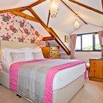 Spacious king bedded ensuite bedroom with beautiful views