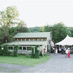 The barn with a tent setup in front