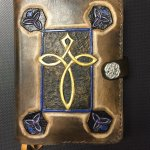 Custom Leather cover for a prayer book designed by The Elizabeth Collection