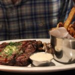 He got the steak with a side of mushrooms! The steak had a great amount of flavor and was very t