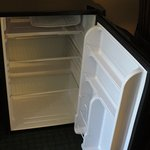 Small fridge with no place on door for much of anything